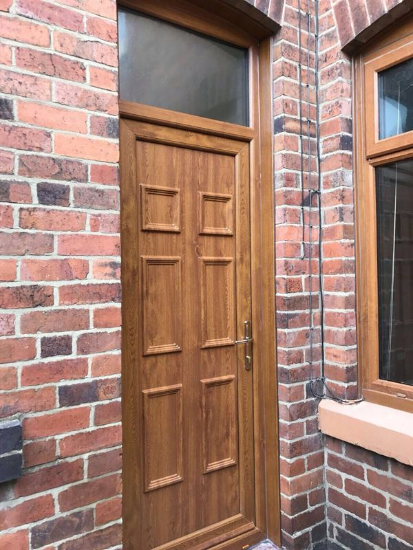 Wooden Door Installation in Stoke on Trent with Golden Oak Finish